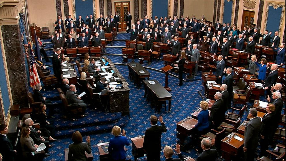 Photo Courtesy: ABC News  99 U.S. Senators take the oath on impeachment by Chief Justice John Roberts.